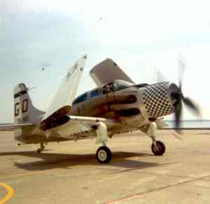 An A-1E taxiing on a seawall